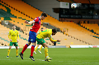 20th March 2021; Carrow Road, Norwich, Norfolk, England, English Football League Championship Football, Norwich versus Blackburn Rovers; Darragh Lenihan of Blackburn Rovers heads the ball clear from Emi Buendia of Norwich City