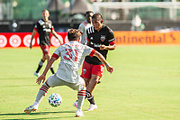 LAKE BUENA VISTA, FL - JULY 13: Tsubasa Endoh #31 of Toronto FC and Edison Flores #10 of DC United battle for the ball during a game between D.C. United and Toronto FC at Wide World of Sports on July 13, 2020 in Lake Buena Vista, Florida.