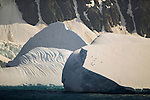 Chinstrap Penguins take refuge on a massive iceberg.
