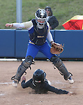 Reed's Kate Dennis jumps over Rancho's Alexa Lira during NIAA DI softball action at the University of Nevada, in Reno, Nev., on Friday, May 20, 2016. Rancho won 12-0 in five innings to advance to the championship. Cathleen Allison/Las Vegas Review-Journal