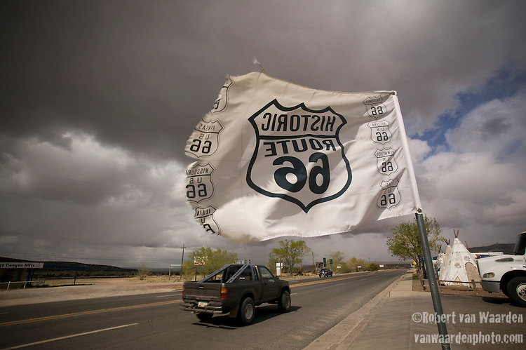 A truck heads down Route 66 on the way out of Seligman, Arizona