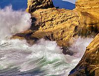 Cape Kiwanda with waves at sunset, Oregon.