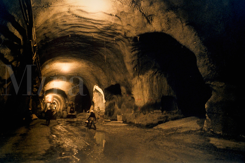 View of a rail station site in a tunnel being built.