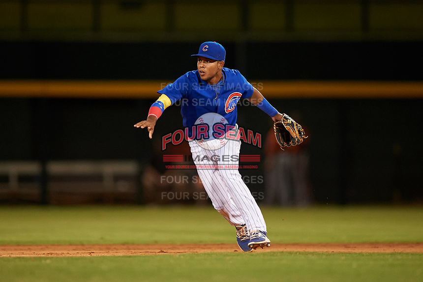 AZL Cubs 1 second baseman Oswaldo Pina (60) underhands a ball to the shortstop during an Arizona League game against the AZL Giants Orange on July 10, 2019 at Sloan Park in Mesa, Arizona. The AZL Giants Orange defeated the AZL Cubs 1 13-8. (Zachary Lucy/Four Seam Images)