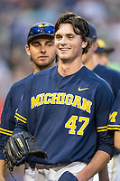 Michigan Wolverines pitcher Tommy Henry (47) smiles as he walks back to the dugout in between innings against the Florida State Seminoles during the NCAA College World Series on June 17, 2019 at TD Ameritrade Park in Omaha, Nebraska. Henry pitched a complete game as Michigan defeated Florida State 2-0. (Andrew Woolley/Four Seam Images)