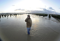 The driver of a wrecked car is seen on the road of La Ina, near Jerez de la Frontera in Cadiz is pictured after it was closed on january 05, 2010 for the heavy rain. (c)Pedro ARMESTRE.