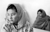 Adela (18) in the hospital in Jagori, Afghanistan on Thursday,  June 20, 2002. An ethnic Hazara, she has just returned to Afghanistan after growing up as a refugee in Germany. Unable to read and write the local language, she is finding daily life difficult, and says she often feels like a stranger in her own land. More than six million people fled Afghanistan during the years of conflict following the Soviet invasion in 1979.