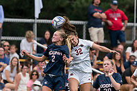 NEWTON, MA - AUGUST 29: Chloe Landers #2 of University of Connecticut  and Jessica Carlton #32 of Boston College battle for head ball during a game between University of Connecticut and Boston College at Newton Campus Soccer Field on August 29, 2021 in Newton, Massachusetts.