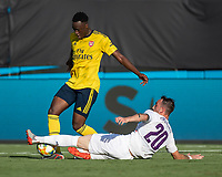 CHARLOTTE, NC - JULY 20: James Olayinka #52 and Gaetano Castrovilli #20 battle for the ball during a game between ACF Fiorentina and Arsenal at Bank of America Stadium on July 20, 2019 in Charlotte, North Carolina.