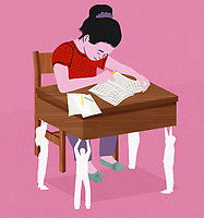Young girl working at school desk being supported by other people