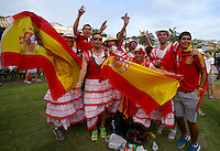 Spain supporters cheer their side on wearing dresses outside Arena Fonte Nova, Salvador