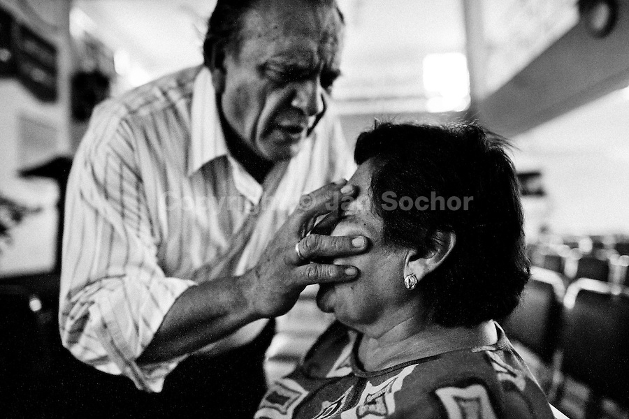 Pastor Hugo Alvarez performs the exorcism ritual on a follower of the Church of the Divine Saviour in Mexico City, Mexico, 31 May 2011. Exorcism is an ancient religious technique of evicting spirits, generally called demons or evil, from a person which is believed to be possessed. Although the formal catholic rite of exorcism is rarely seen and must be only conducted by a designated priest, there are many Christian pastors and preachers (known as 'exorcistas') performing exorcism and prayers of liberation. Using their strong charisma, special skills and religous formulas, they command the evil spirit to depart a victim's mind and body, usually invoking Jesus Christ or God to intervene in favour of a possessed person.