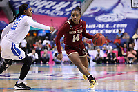 GREENSBORO, NC - MARCH 06: Marnelle Garraud #14 of Boston College drives past Mikayla Boykin #12 of Duke University during a game between Boston College and Duke at Greensboro Coliseum on March 06, 2020 in Greensboro, North Carolina.