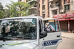 Kolkata Police request people to go back home after the relaxed period of the day for shopping is over. India is going through a toal lock down for 21 days due to corona virus pandemic.  Kolkata, West Bengal, India. Arindam Mukherjee