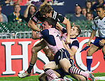 Sam Dickson takes the tackle. Hong Kong Sevens, 27 March 2015. NZ beat Scotland in game one 26-7. Photo: Marc Weakley