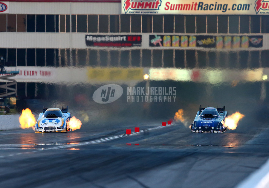 May 17, 2014; Commerce, GA, USA; NHRA funny car driver Matt Hagan (left) races alongside Robert Hight during qualifying for the Southern Nationals at Atlanta Dragway. Mandatory Credit: Mark J. Rebilas-USA TODAY Sports