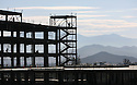 As mountains to the east of I-215 are silhouetted by the morning sun in July, 2009, Loma Linda University Medical Center-Murrieta stands under construction in Murrieta, California. The center opened in early 2011.  for The Californian