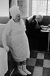 Phobia irrational or obsessive fear anxiety. This woman dressed only all in white, she needs to feel clean and had a fear of germs. Strangely she  was often to be found in Whiteleys department store in Bayswater, West London  during the early 1970s. Seen here in the cafe at the top of the store.1971.
