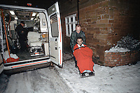 Paramedic crew taking a patient in a wheelchair to there waiting ambulance. This image may only be used to portray the subject in a positive manner..©shoutpictures.com..john@shoutpictures.com