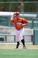 GCL Orioles third baseman Garrett Copeland (15) throws to first during a game against the GCL Red Sox on August 16, 2016 at the Ed Smith Stadium in Sarasota, Florida.  GCL Red Sox defeated GCL Orioles 2-0.  (Mike Janes/Four Seam Images)