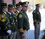 Sheriff Kenny Furlong watches as the Carson City Sheriff's Honor Guard raises the American flag during a flag pole dedication ceremony at the Carson City Sheriff's Office in Carson City, Nev., on Wednesday, April 24, 2013. .Photo by Cathleen Allison