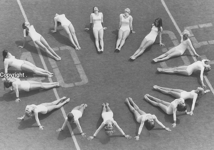 1972 FILE PHOTO -<br /> <br /> Practising Estonian Gymnastics, girls from all over the world rehearse at the Canadian National Exhibition yesterday for tonight's grand finale of the Estonian World Festival. More than 500 gymnasts will take part in the show, a highlight of a week-long meeting here of 12,000 Estonians from 14 countries, including 10,000 in Metro, the World's largest colony of Estonians.
