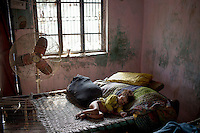 A boy belonging to the Babaria caste sleeps on a bed. The Babaria are a major source of illegally traded tiger parts since they used to hunt them when it was legal to do so and now sell them to traffickers.