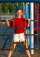 Girl playing at a playground.