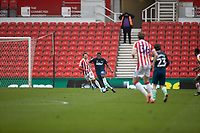 20th March 2021; Bet365 Stadium, Stoke, Staffordshire, England; English Football League Championship Football, Stoke City versus Derby County; Teden Mengi of Derby County under pressure from Nick Powell of Stoke City