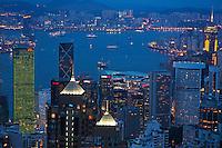 Kowloon skyline and Victoria Harbour at dusk, Hong Kong Island, Hong Kong, China.