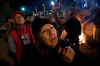 Relatives of the trapped miners react to their final rescue in San Jose mine, north of Chile