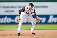 Lansing Lugnuts third baseman Kellen Sweeney (10) on defense against the Beloit Snappers at Cooley Law School Stadium on May 5, 2013 in Lansing, Michigan.  The Lugnuts defeated the Snappers 5-4.  (Brian Westerholt/Four Seam Images)