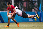 Ruzaini Bin Mohamad (l) of Singapore fights for the ball with Ryno De Bruyn of United Arab Emirates during the match between United Arab Emirates and Singapore of the Asia Rugby U20 Sevens Series 2016 on 12 August 2016 at the King's Park, in Hong Kong, China. Photo by Marcio Machado / Power Sport Images