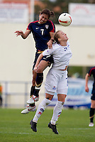 USWNT midfielder (7) Shannon Boxx goes up for a header against Iceland's (7) Dora Stefansdottir during the Algarve Cup.  The USWNT defeated Iceland, 1-0, at Ferreiras, Portugal.