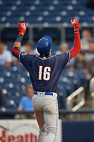 New Hampshire Fisher Cats shortstop Lourdes Gurriel Jr. (16) points skyward as he crosses home plate after hitting a home run in the top of the ninth inning during a game against the Trenton Thunder on August 19, 2018 at ARM & HAMMER Park in Trenton, New Jersey.  New Hampshire defeated Trenton 12-1.  (Mike Janes/Four Seam Images)