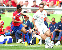 Ireneeusz Jelen (21) of Poland gets away from Michael Umana (4) of Costa Rica. Poland defeated Costa Rica 2-1 in their FIFA World Cup Group A match at FIFA World Cup Stadium, Hanover, Germany, June 20, 2006.