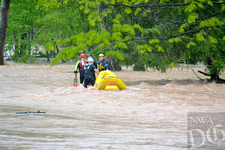 Bella Vista and Rogers Fire Department water rescue personnel assisted Little FLock in rescuing two men from the flood waters on Rustic Drive in Little Flock as well as five people and two dogs from a residence at 1626 Rustic Dr.<br /> (Pea Ridge Times/Annette Beard)