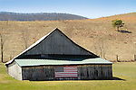 Scenic route 42, Craig County, VA with barn and american flag. Early Spring.