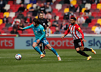 22nd May 2021; Brentford Community Stadium, London, England; English Football League Championship Football, Playoff, Brentford FC versus Bournemouth; Ben Pearson of Bournemouth being marked by Saman Ghoddos of Brentford