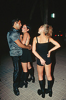 Spain. Mallorca in the Balearic islands. Palma. Swiss tourists( two young women) flirt at night with a nice and handsome local man. © 1999 Didier Ruef