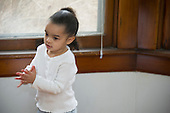 MR / Schenectady, NY. Pre-school aged child (girl, 3, African American and Caucasian) claps her hands MR: Dal5. ID: AM-HD. © Ellen B. Senisi