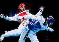 10 AUG 2012 - LONDON, GBR - Yousef Karami (IRI) (left) of Iran and Nicolas Garcia Hemme (ESP) (right) of Spain trade kicks during their men's -80kg category preliminary round contest at the London 2012 Olympic Games Taekwondo at Excel in London, Great Britain .(PHOTO (C) 2012 NIGEL FARROW)