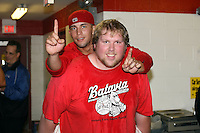 September 7 2008:  Jose Garcia of the Batavia Muckdogs, Class-A affiliate of the St. Louis Cardinals, celebrates winning the Pinckney Division after a game at Dwyer Stadium in Batavia, NY.  Photo by:  Mike Janes/Four Seam Images
