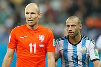Arjen Robben of the Netherlands and Javier Mascherano of Argentina
