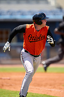 FCL Orioles Orange Jacob Teter (26) runs to first base after his first professional hit during a game against the FCL Rays on August 2, 2021 at Charlotte Sports Park in Port Charlotte, Florida.  (Mike Janes/Four Seam Images)