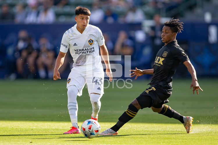 CARSON, CA - MAY 8: Adam Saldana #43 of the Los Angeles Galaxy passes off the ball during a game between Los Angeles FC and Los Angeles Galaxy at Dignity Health Sports Park on May 8, 2021 in Carson, California.