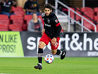 WASHINGTON, DC - MAY 13: Adrien Perez #16 of D.C. United dribbles during a game between Chicago Fire FC and D.C. United at Audi FIeld on May 13, 2021 in Washington, DC.