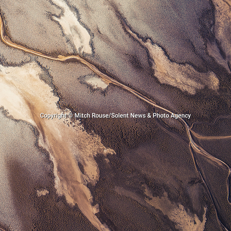 Aerial shots show the incredible array of textures that make up the Death Valley National Park.  The abstract images show land patterns and mineral deposits from streams as well as pools created by melted snow and rainwater.<br /> <br /> The pictures of the park, which straddles the border between eastern California and Nevada, were taken by veteran photographer Mitch Rouse from his helicopter.  SEE OUR COPY FOR DETAILS.<br /> <br /> Please byline: Mitch Rouse/Solent News<br /> <br /> © Mitch Rouse/Solent News & Photo Agency<br /> UK +44 (0) 2380 458800
