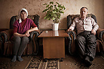 Ludmila and Mikhail Smolin at home. They both work on the mechanical plant in the first shop: she since 1974, he works there as a metalworker since 1973. Russia, Sverdlovsk Oblast, Arty village, May 2009