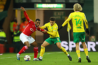 2nd January 2021; Carrow Road, Norwich, Norfolk, England, English Football League Championship Football, Norwich versus Barnsley; Victor Adeboyejo of Barnsley competes for the ball with Max Aaron of Norwich City